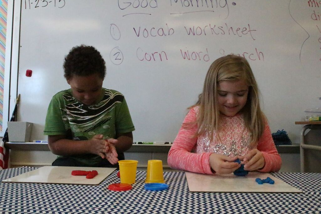 students working with play dough