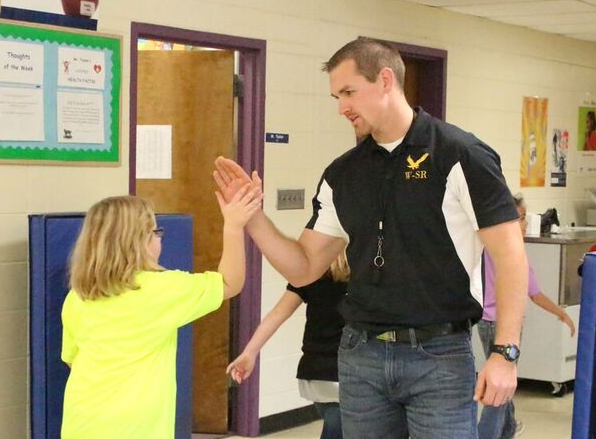 teacher giving student high five