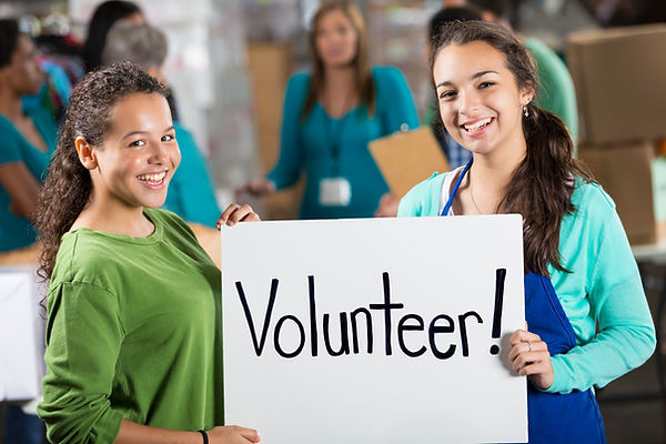 Volunteers with sign.jpg