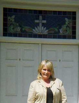 Psychic Barbara Mackey visiting the yellow frame church in Sussex, NJ, frequented by her ancestor, Dr. Samuel Kennedy