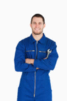 Smiling young mechanic in boiler suit wi
