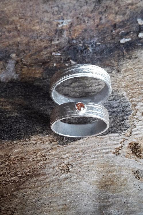 """Zilveren """"samen"""" ringen."""