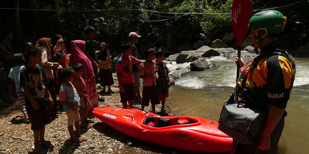 Flo Fischer greeted by local kids on the Lamasi River, Sulawesi