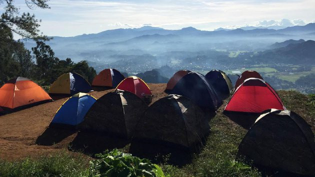 Rows of tents stand on the To'tombi campsite in the Lolai highland, North Toraja. This area has become increasingly popular, with travelers flocking there every day to witness the thick rolling white fog that looks like clouds. Lolai has become a tourism magnet in Toraja.