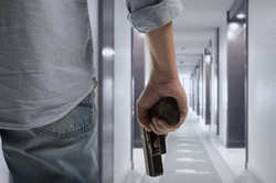 Gun-man-holding-gun-at-side