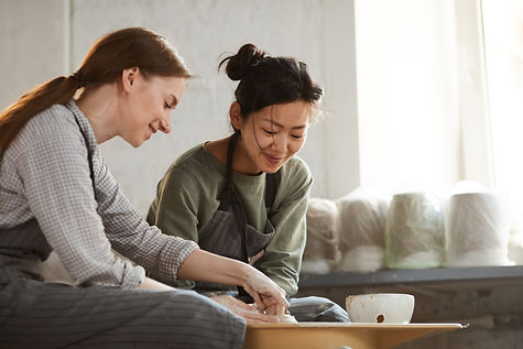 content-multi-ethnic-women-creating-clay