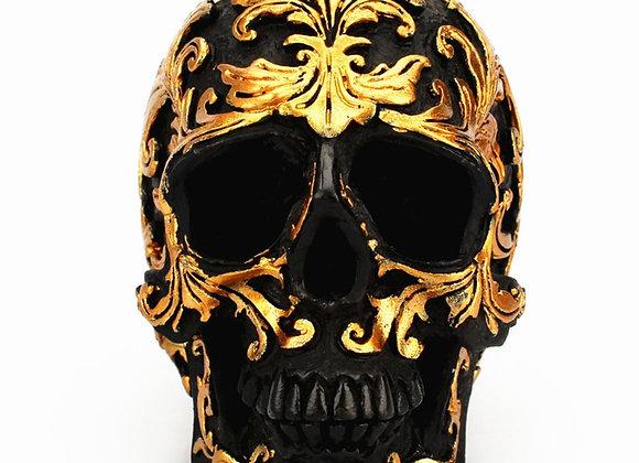 Svart kranium med rankor i guld