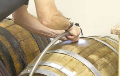 Transferring wine to Oak barrel for ageing