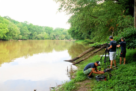 Crew on bank of Congaree River