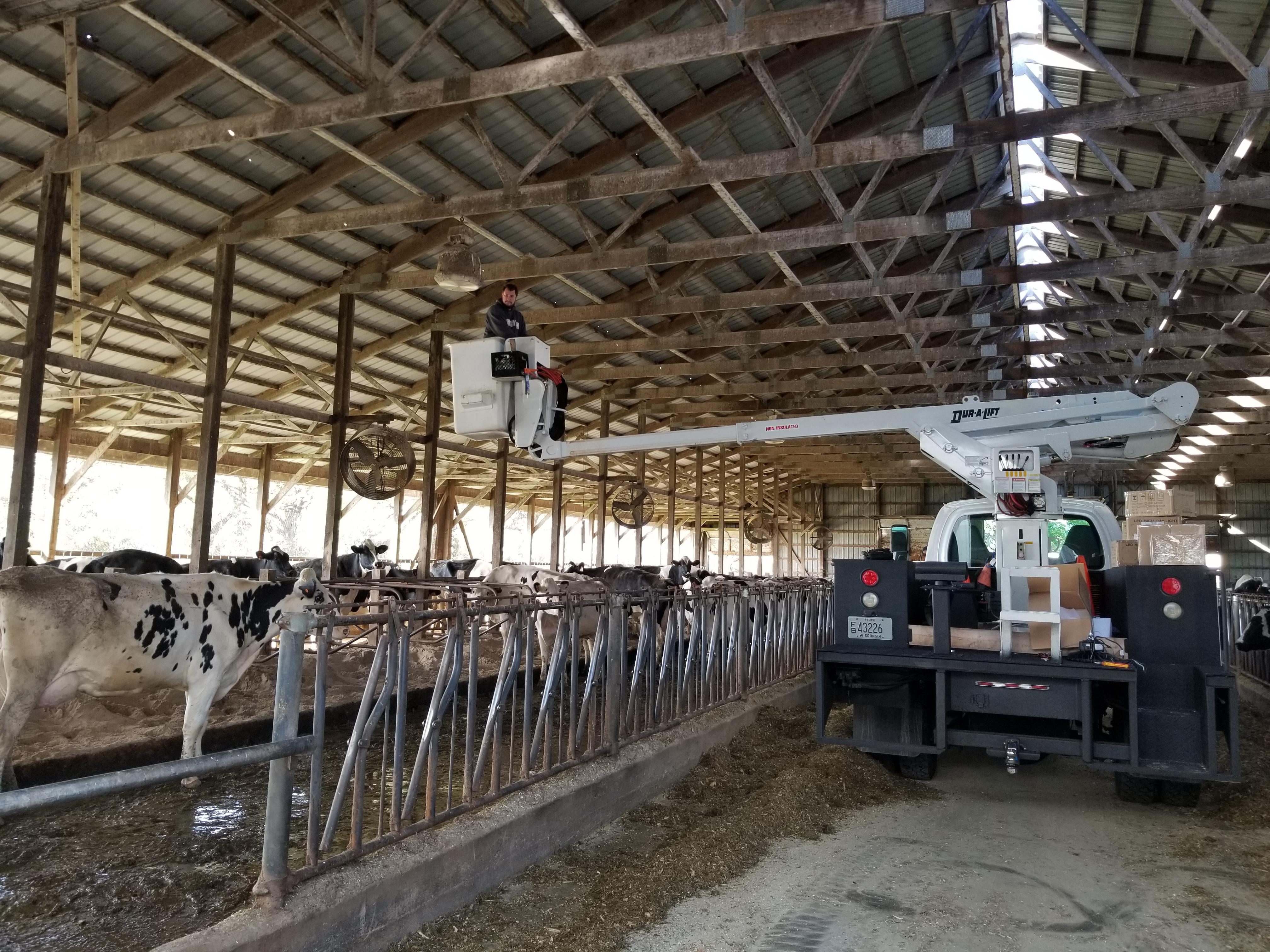 Boom truck dairy barn