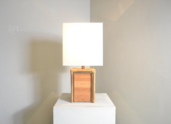 Rattan and brass table lamp.