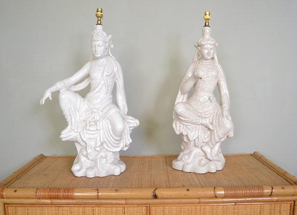 Pair of ceramic deity lamps.