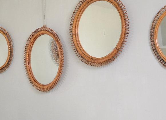 Pair of rattan mirrors.