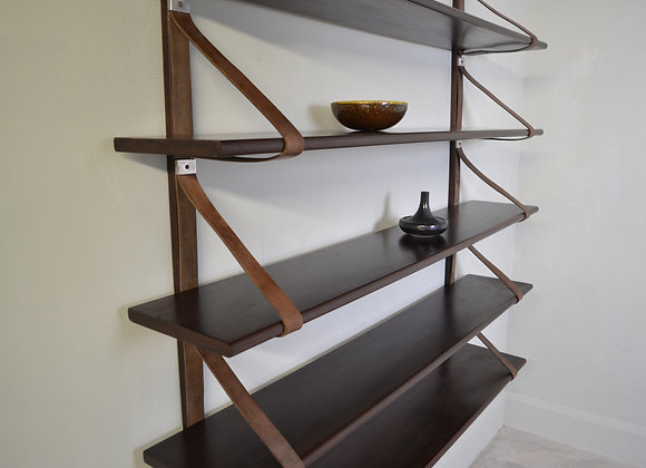Wall mounted book shelves.
