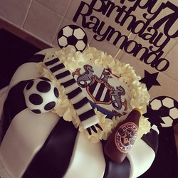 70th birthday cake for a Newcastle Unite