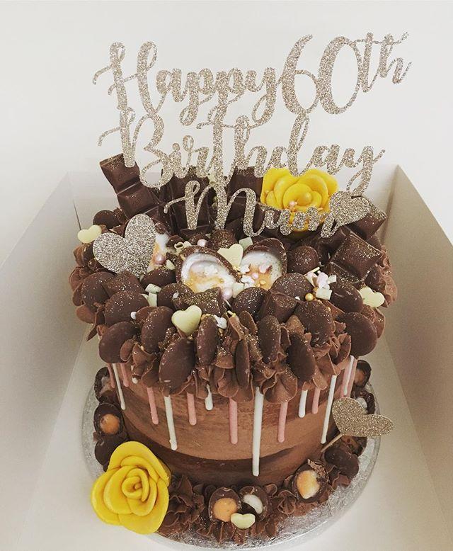 Chocolate cake topped with cadburys piec