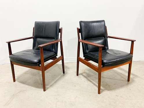 Arms chairs by Arne Vodder in Rosewood and leather