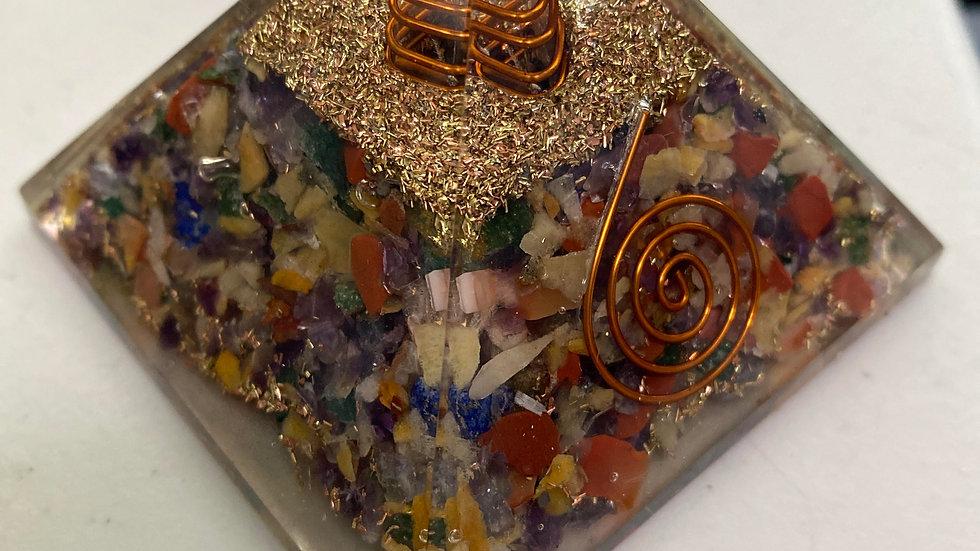 Mix of chakra crystals. 65mm orgone pyramid