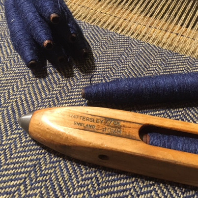 The pirns and shuttle all prepped in Navy for your shawl.