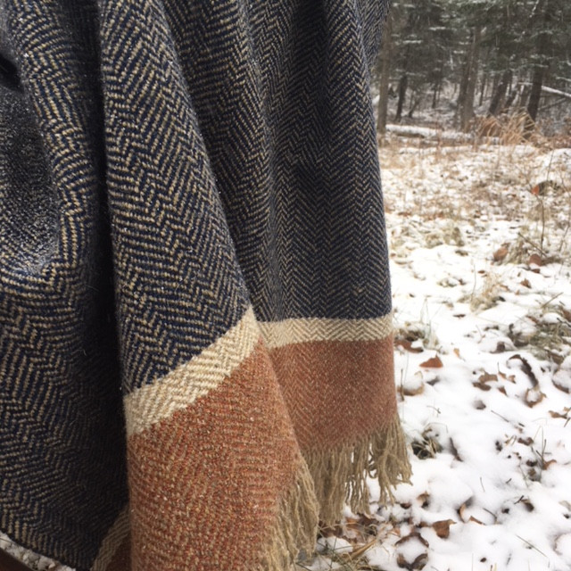 A beautiful drape as the shawl naturally hangs.