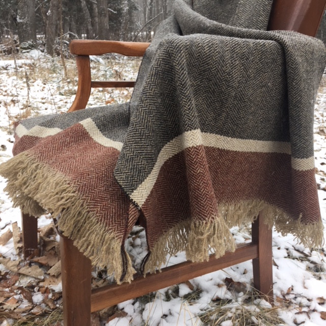 The colors of this shawl feel both sharp and earthy, a unique and classy combo.