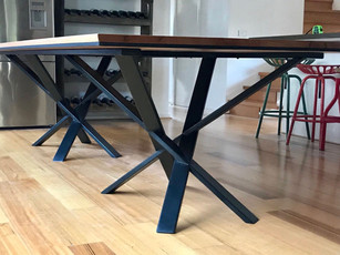 Recycled timber dining table with powdercoated steel legs