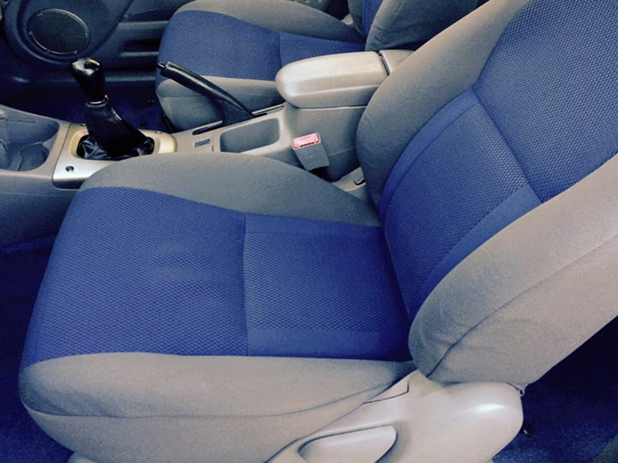 Shampoo vaccum on seat at Sparkling Star Detailing