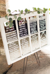 hand lettered mirror seating chart