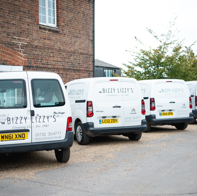 Bizzy Lizzy's Cleaning Co vans ready to go