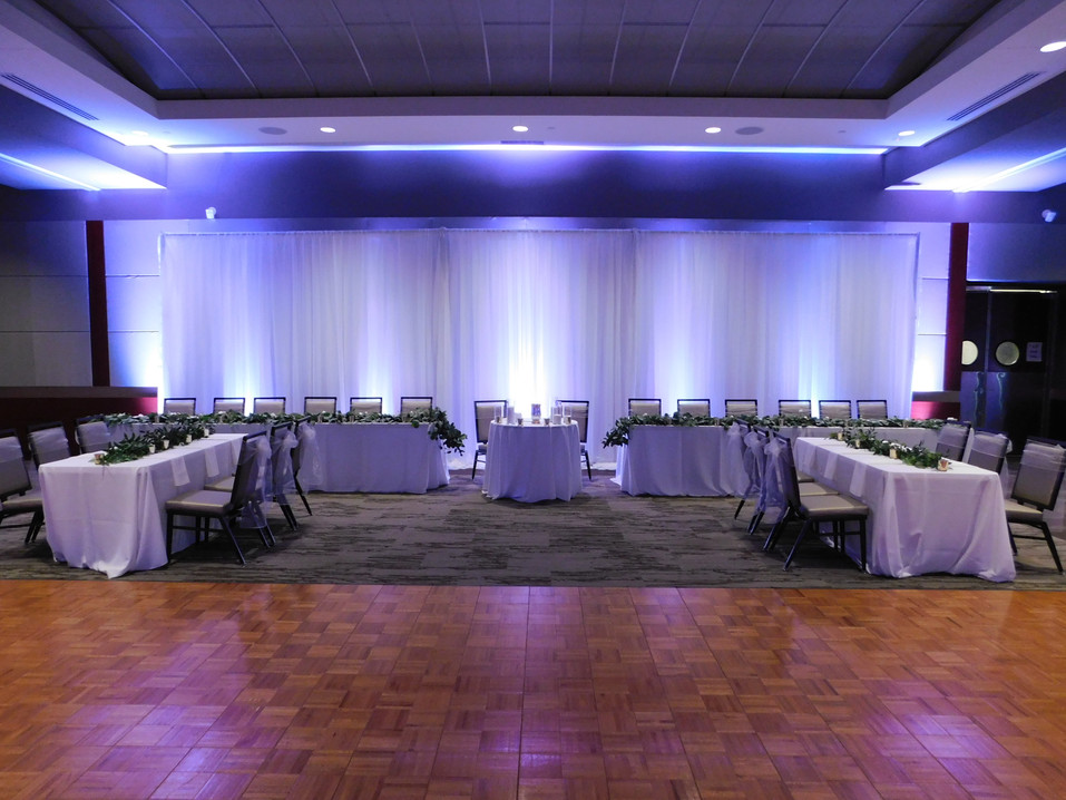 Dance Floor and Head Table set up in Grand Hall with custom draping.
