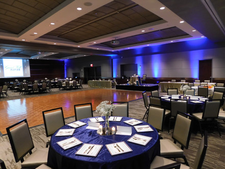Reception seating with dance floor in 2 sections of Grand Hall