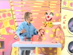 Noel teaches Mr Blobby some DIY...