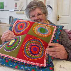 6.Participant with her cushion, made in group of adults with learning difficulties (2017)