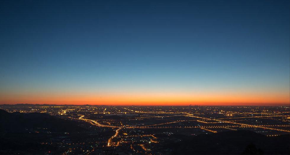 Sunrise over city.jpg