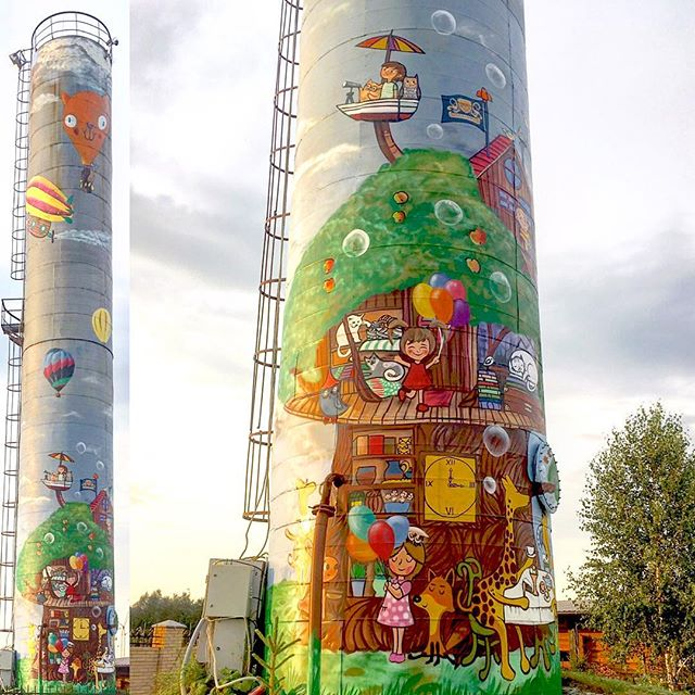 #artwork by #spraypaint #cans on #watertower #apple #tree #house #animals and #kids #playground #cat