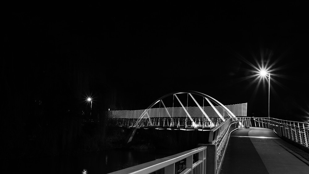 Riverside bridge with light painting trail lucinda price photography