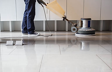 The people cleaning floor with machine..