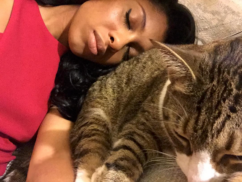 Phenice Arielle takes a cat nap with snuggly kitty