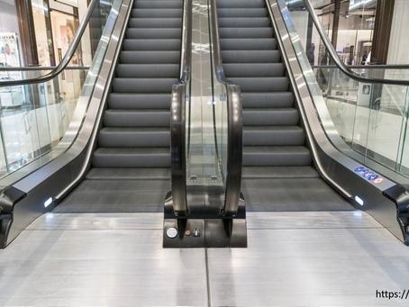 Walking up the down escalator