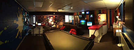A photo of inside St. Paul's Youth Room with games, TV and video game systems.