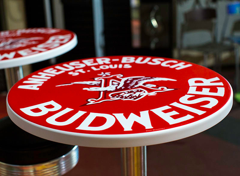 Powder-coated graphics aluminum table with red and white graphics
