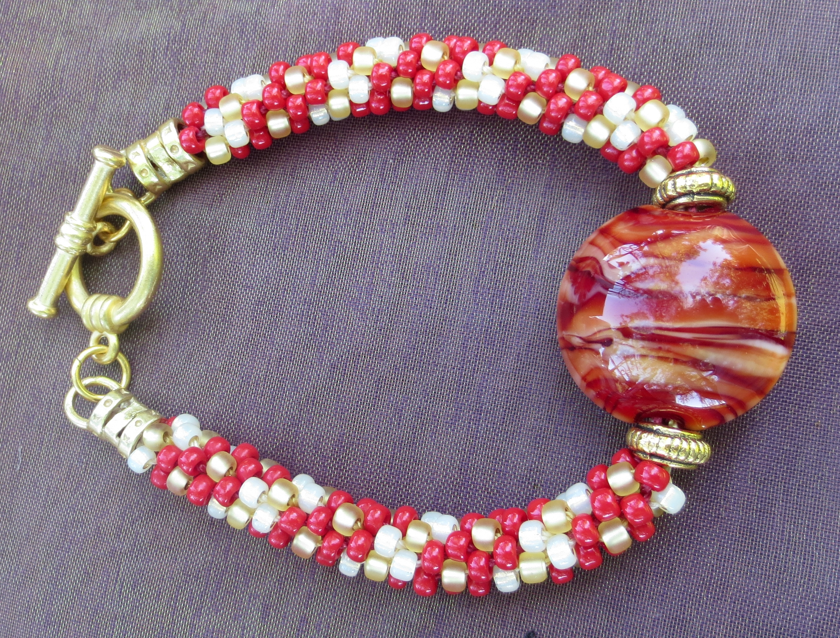 Varigated Red Lentil with Beaded Kumihimo Bracelet