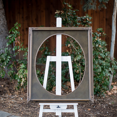 20x24 brown frame with oval inlay