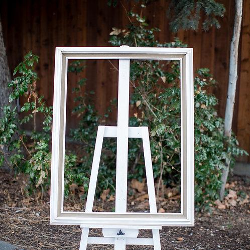 27x36 white frame with tan felt