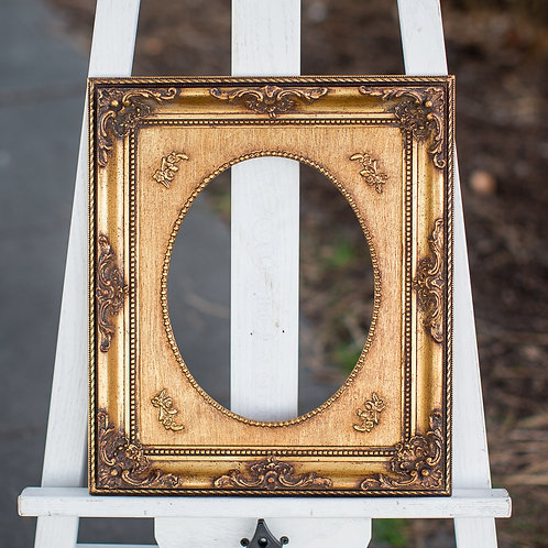 8x10 ornate gold frame with oval inlay