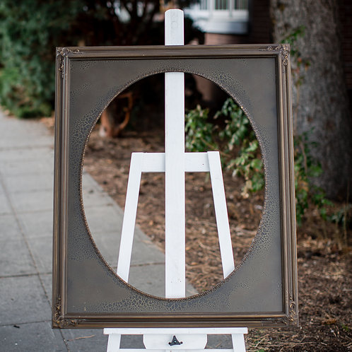24x30 brown ornate frame with oval inlay