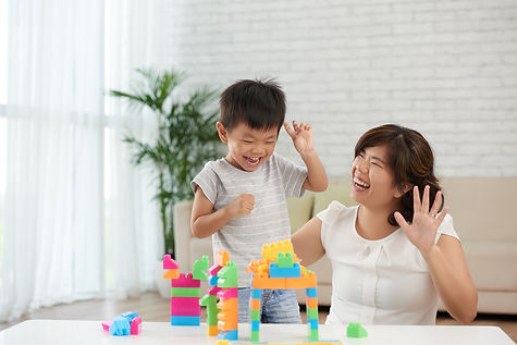 Asian little boy and his mother playing