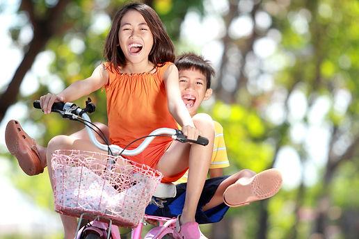 happy smiling kids enjoy riding bicycle