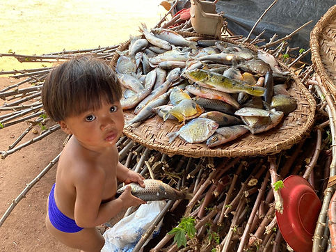 Xingu boy with fish.jpg