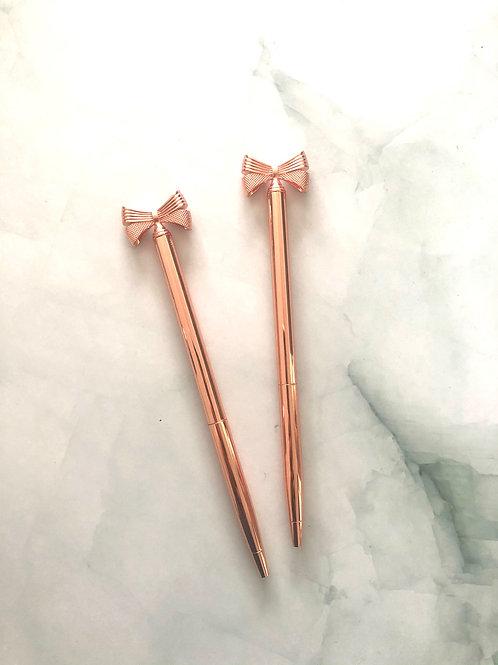 Stylo pointe noire corps métallique rose gold , noeud rose gold